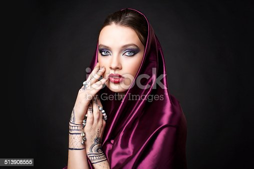 istock beautiful woman in oriental style with mehendi in hijab 513908555