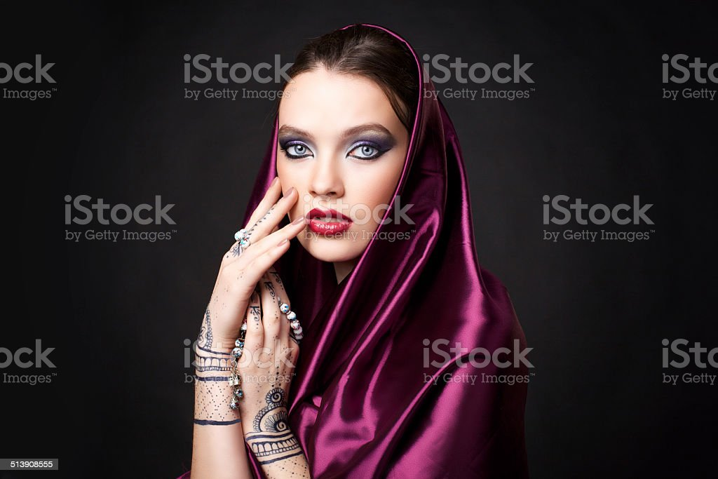 beautiful woman in oriental style with mehendi in hijab stock photo