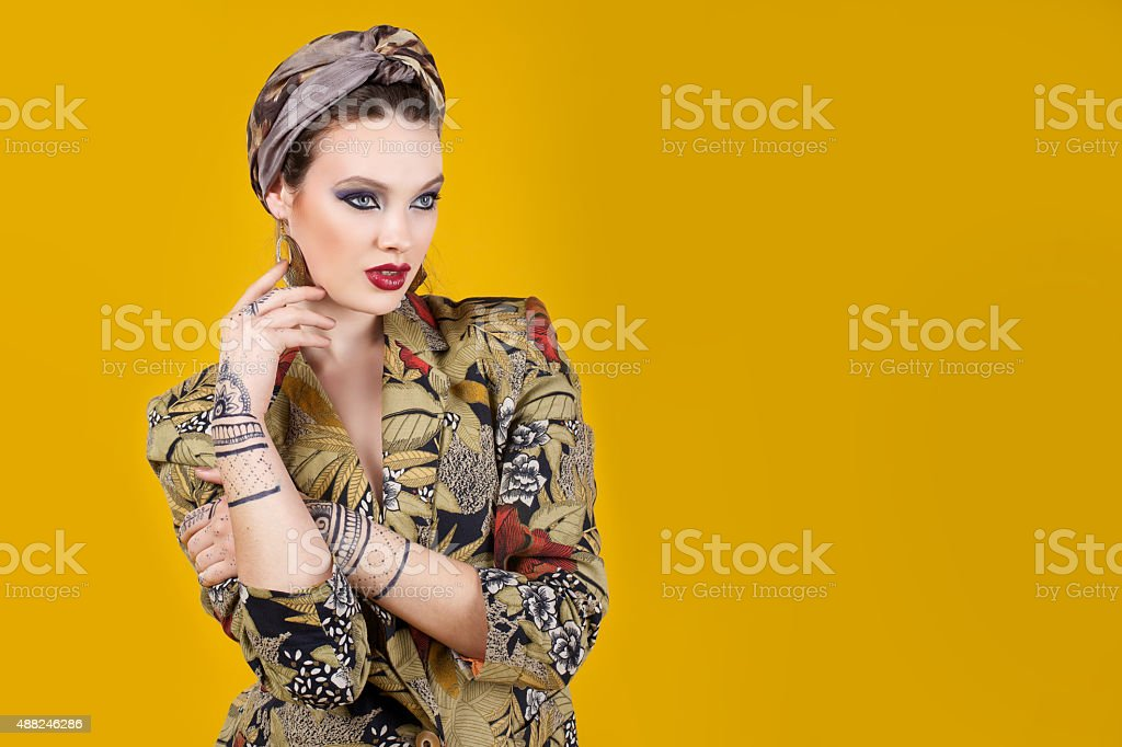 beautiful woman in oriental style with mehendi stock photo
