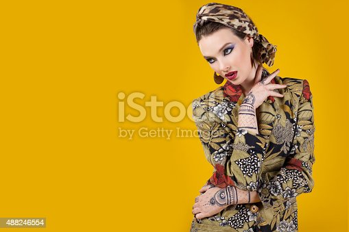 istock beautiful woman in oriental style with mehendy 488246554