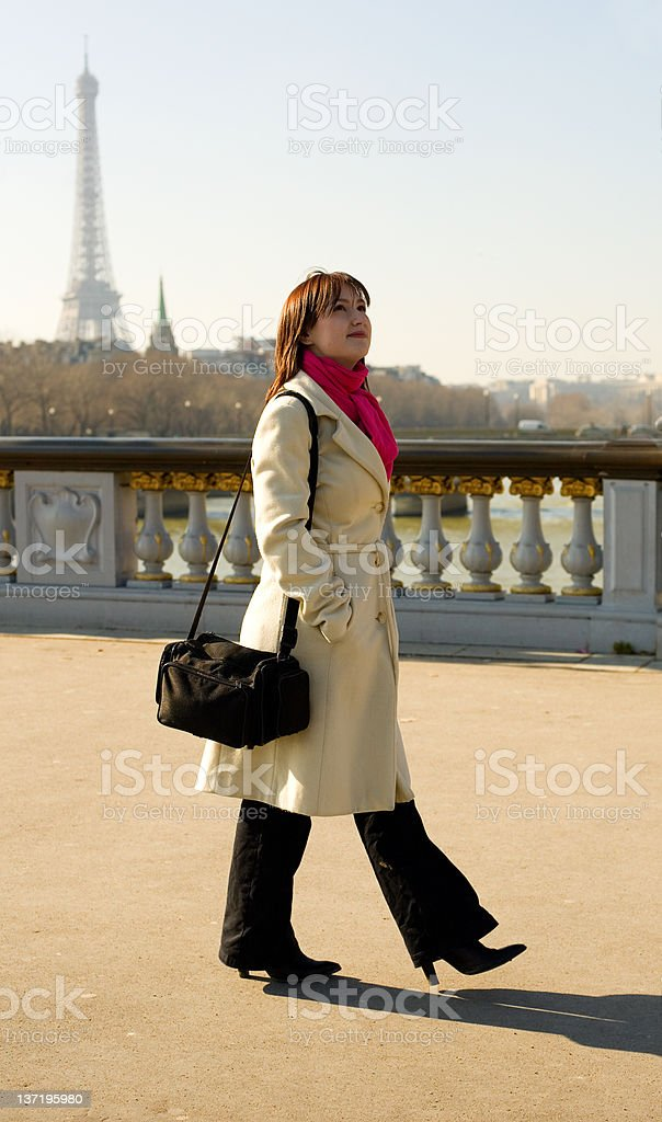 Beautiful woman in Paris walking on the Pont Alexandre III royalty-free stock photo