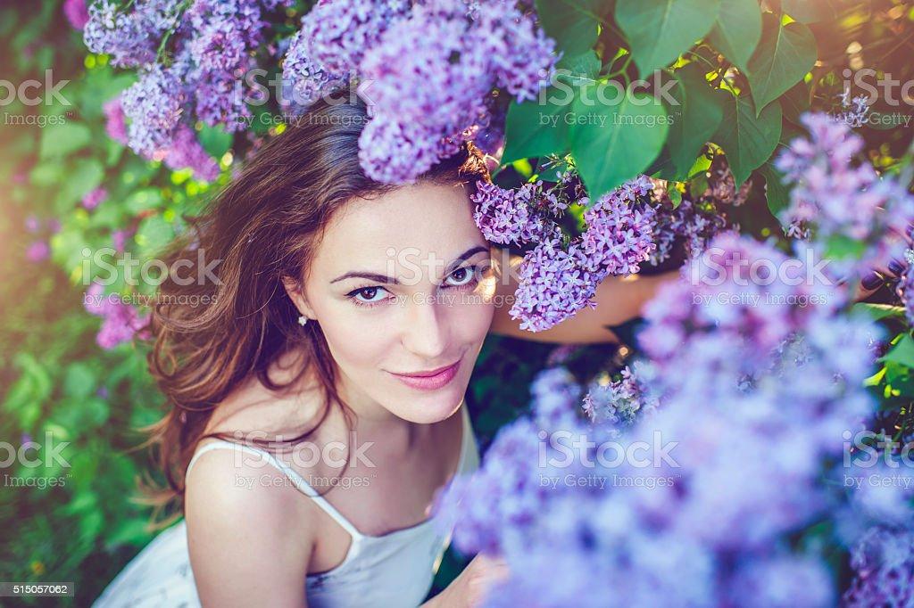Beautiful woman in park stock photo