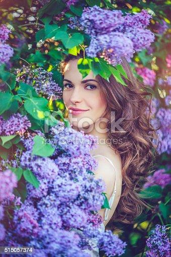 istock Beautiful woman in park 515057374