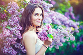 Beautiful woman in lilac park