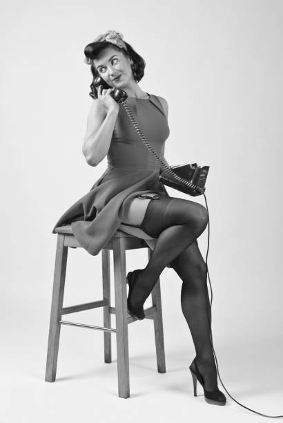 beautiful woman in pin up style with vintage phone. - pin up girl stock pictures, royalty-free photos & images