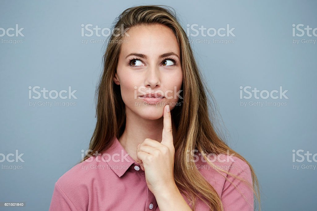 Beautiful woman in pink finding inspiration stock photo