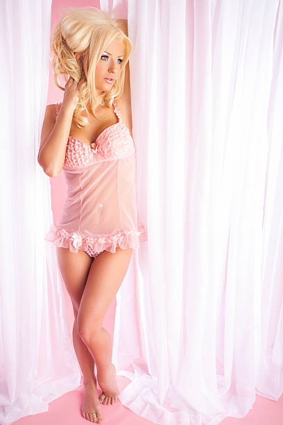 Beautiful woman in pink lingerie stock photo