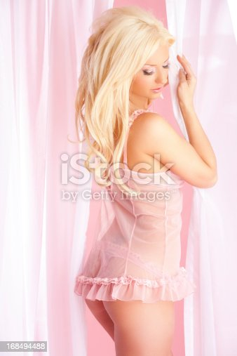 istock Beautiful woman in pink lingerie 168494488