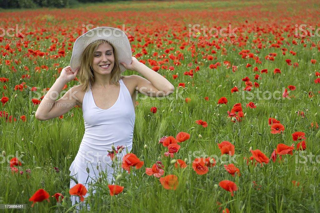 beautiful woman in poppy field royalty-free stock photo