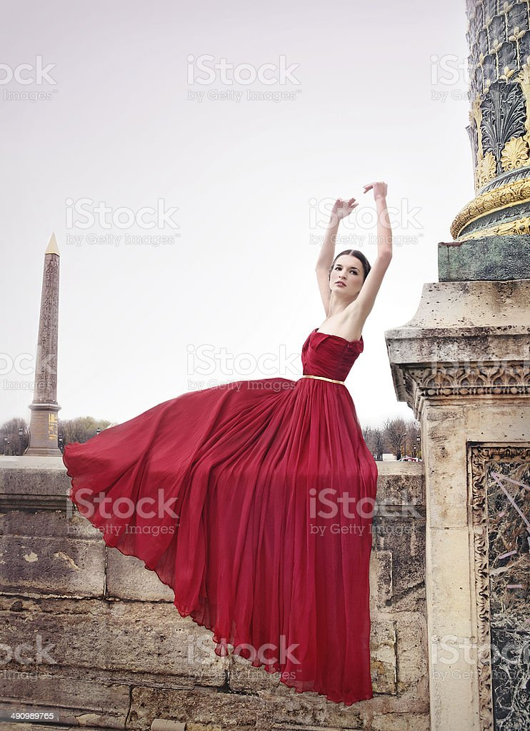 Beautiful woman in red dress, Paris, France stock photo