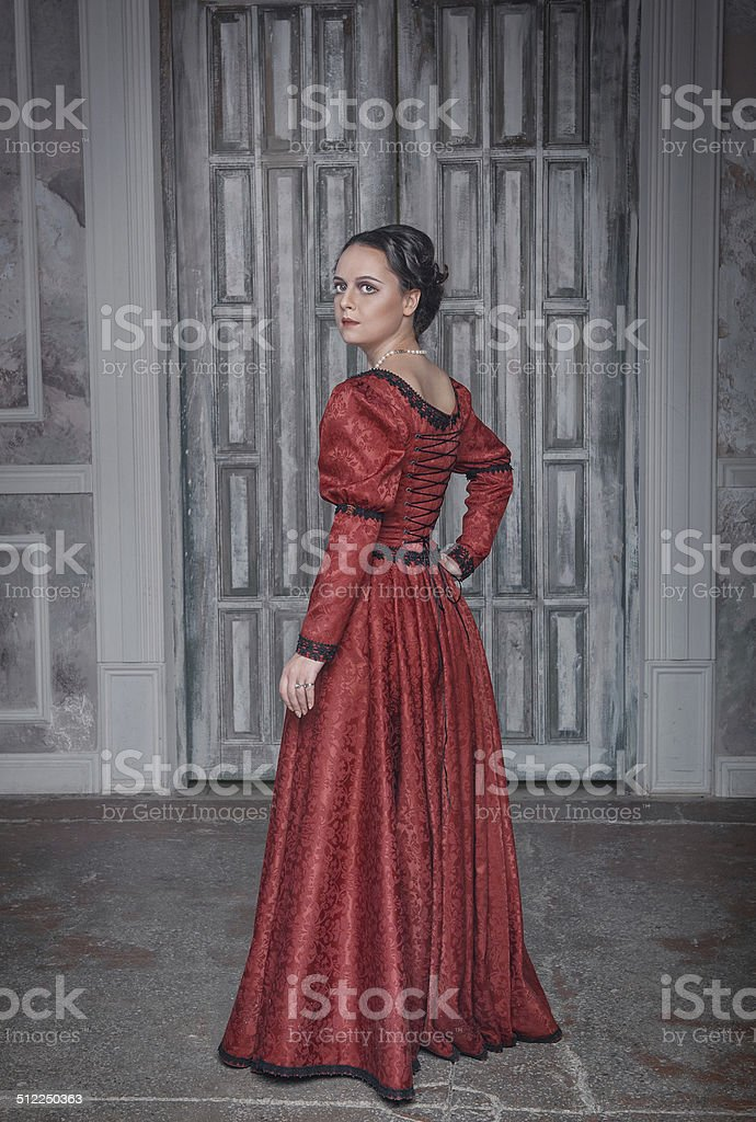 Beautiful woman in red medieval dress stock photo