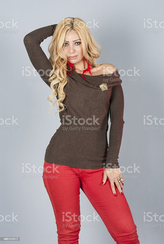 Beautiful woman in red posing for photo shoot stock photo