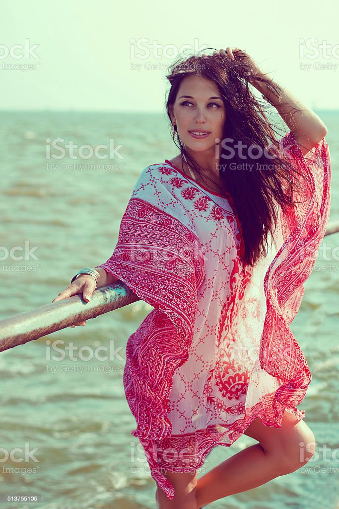Beautiful woman in red white tunic stock photo