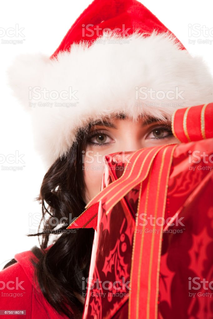 Beautiful woman in santa hat with Christmas present royalty-free stock photo