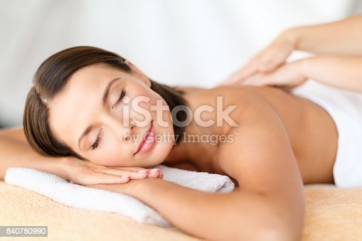 istock beautiful woman in spa salon getting massage 840780990