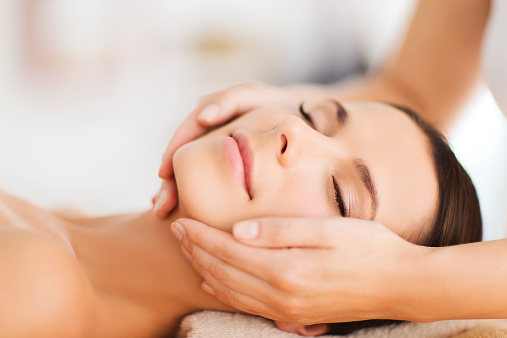 istock beautiful woman in spa salon having facial 526943469