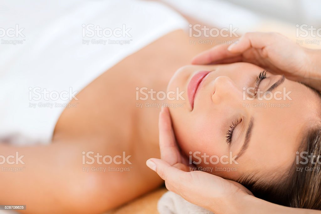beautiful woman in spa salon stock photo