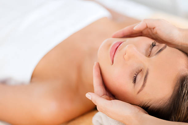 beautiful woman in spa salon - beauty treatment stock photos and pictures