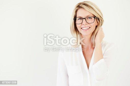 673361134 istock photo Beautiful woman in specs 673361308