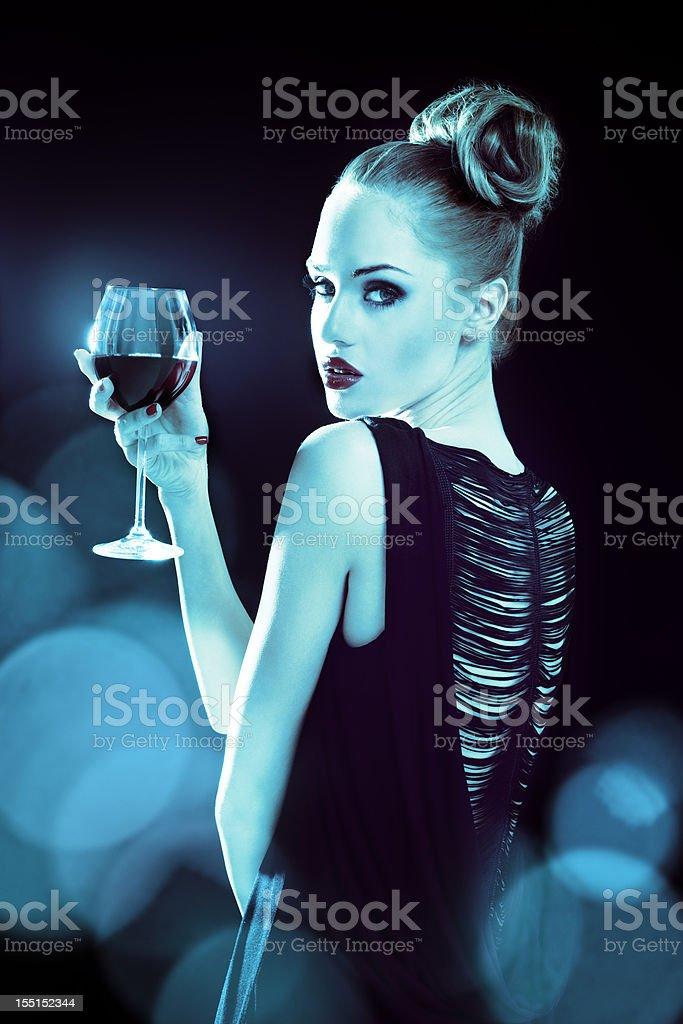 Beautiful woman in spotlights royalty-free stock photo