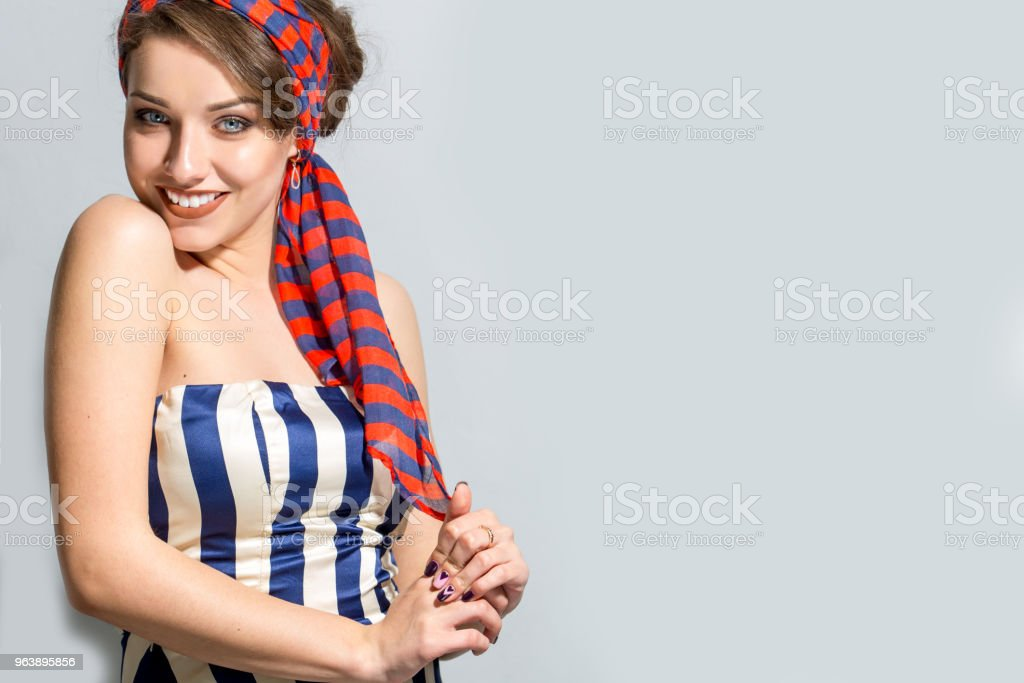Beautiful woman in striped dress stock photo