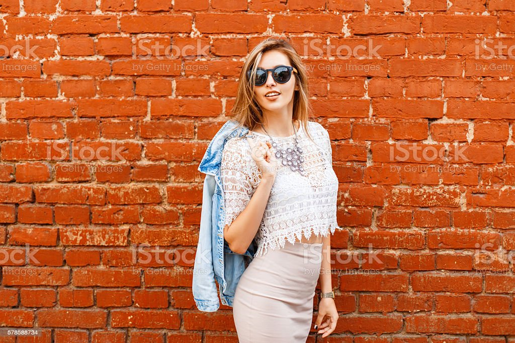 Beautiful woman in stylish vintage white blouse with denim jacket. stock photo