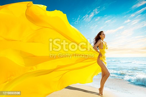 Beautiful Woman in Summer Sexy Dress on Sea Beach, Gown Cloth Waving Fluttering on Wind, Full Length Outdoor Portrait