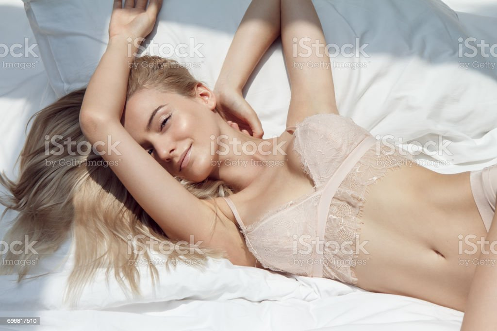 Beautiful woman in the bed stock photo