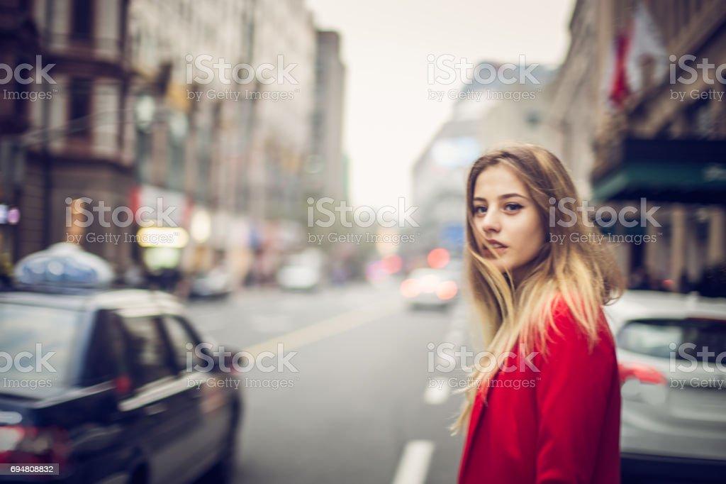 Beautiful woman in the big city stock photo