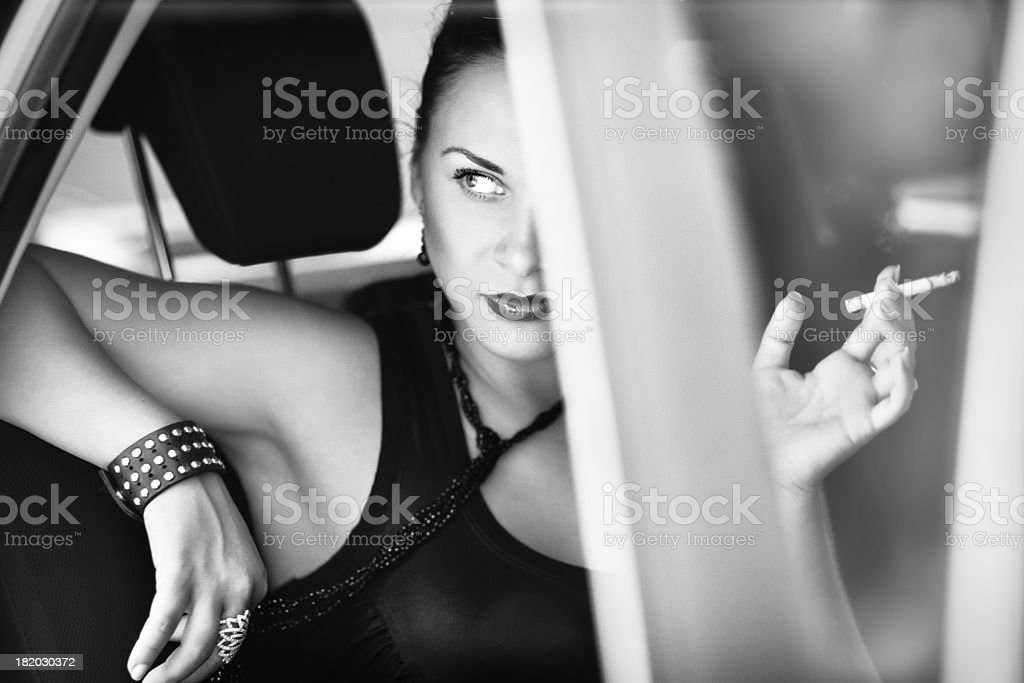 Beautiful woman in the car looks with contempt stock photo