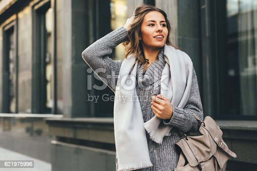 Portrait of a beautiful young woman outdoors.