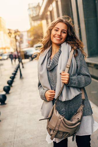 istock Beautiful woman in the city 628014142