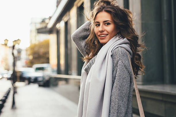 Beautiful woman in the city Portrait of a beautiful young woman outdoors. long hair stock pictures, royalty-free photos & images
