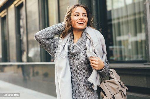 istock Beautiful woman in the city 646381136