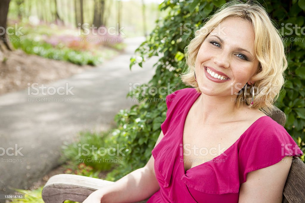 Beautiful Woman in the Garden royalty-free stock photo