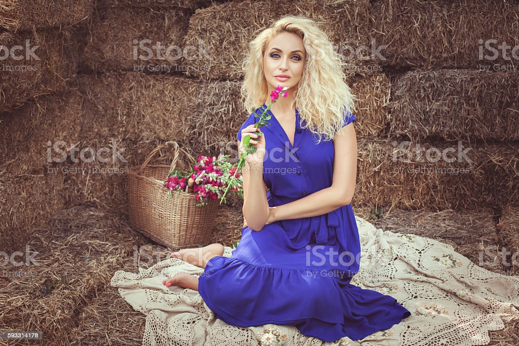 Beautiful woman in the hayloft. stock photo