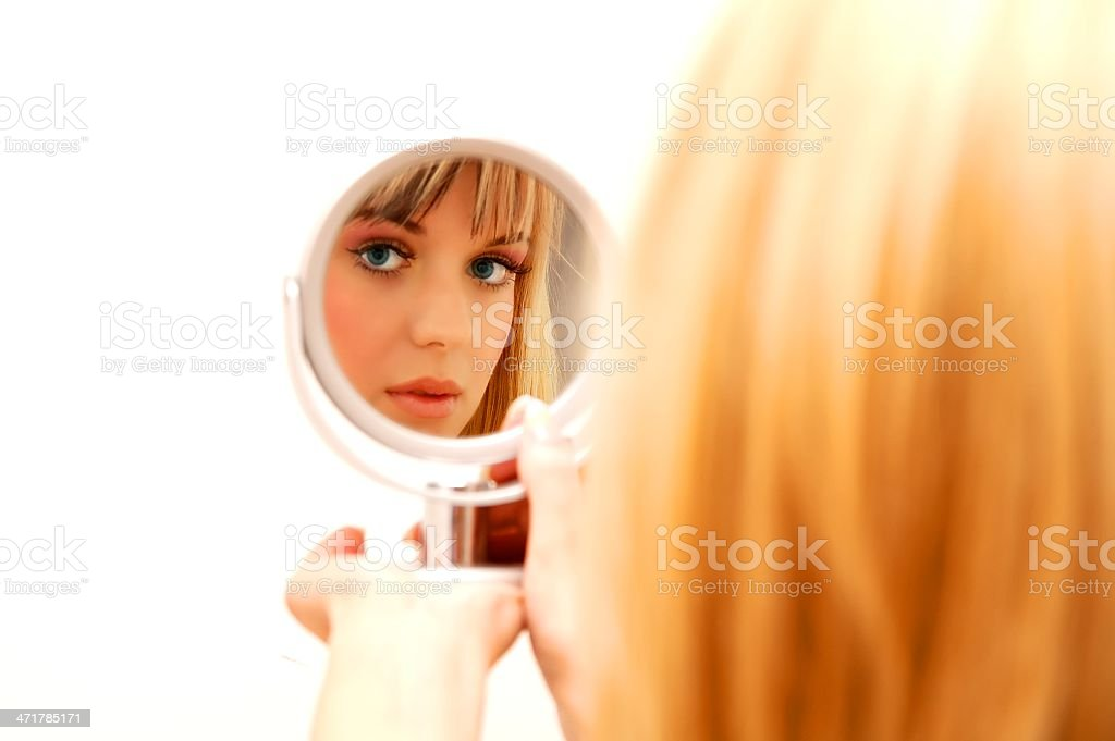 Beautiful woman in the mirror royalty-free stock photo