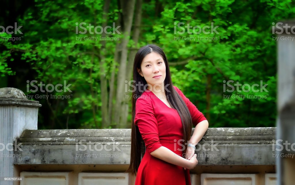 A beautiful woman in the outdoors stock photo