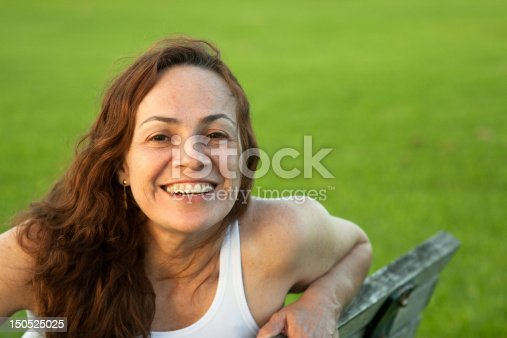 istock Beautiful woman in the park 150525025