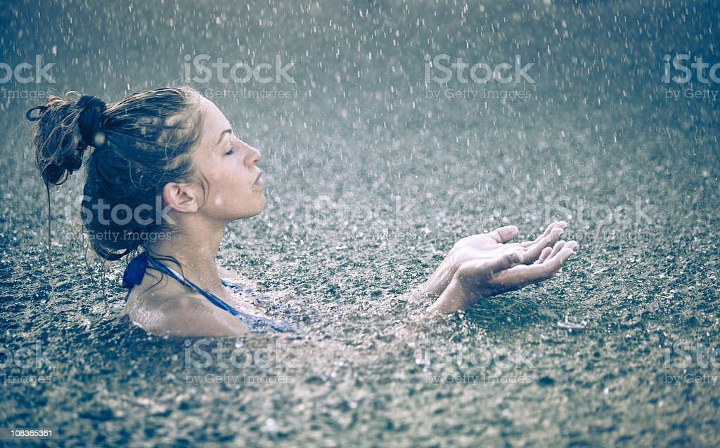Beautiful woman in the rain stock photo