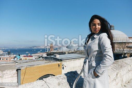 Beautiful woman in the Suleymaniye Mosque enjoying the amazing view of Istanbul, Turkey