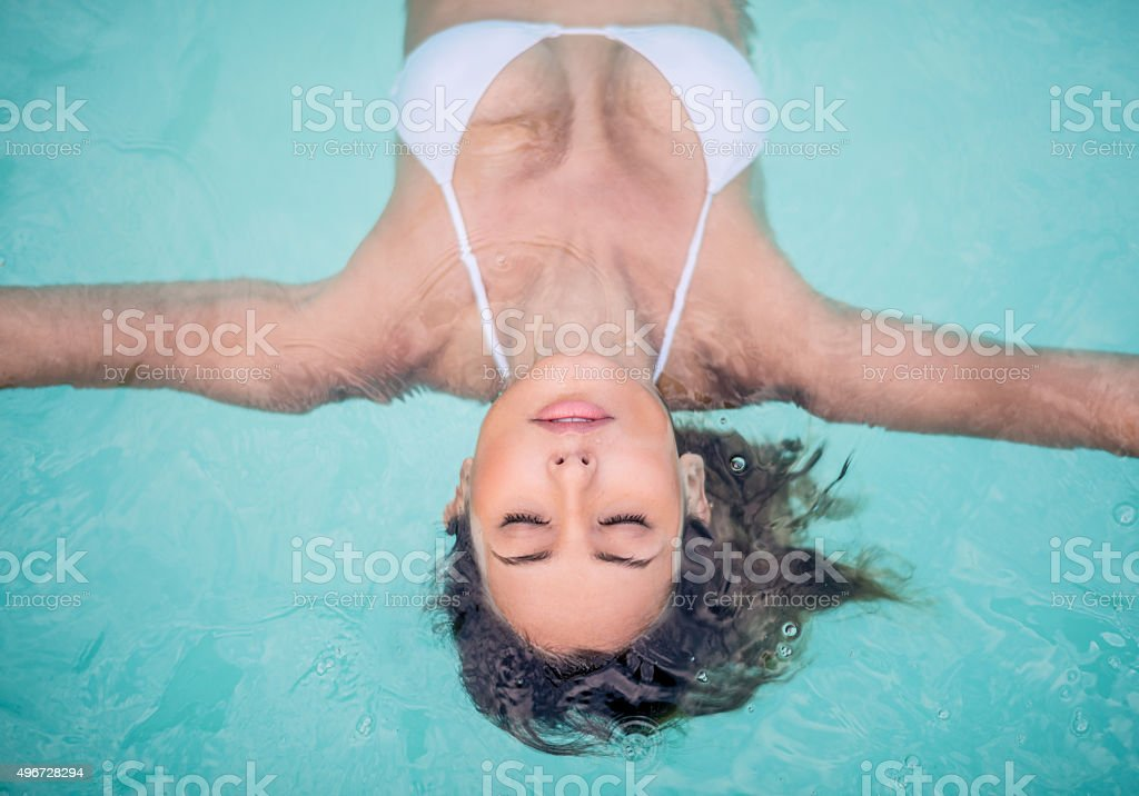 Beautiful woman in the swimming pool at the spa stock photo
