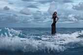 Beautiful woman in the water wave
