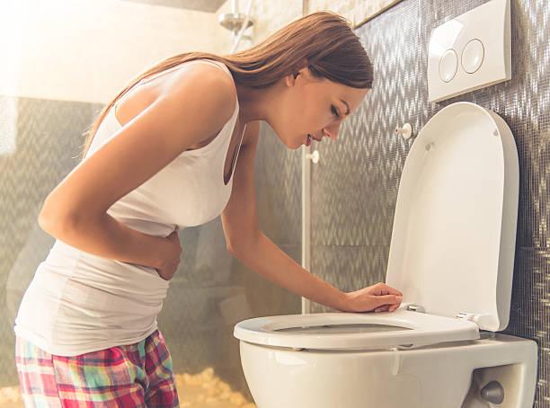 beautiful woman in toilet - übelkeit schwangerschaft stock-fotos und bilder