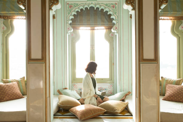 Beautiful Woman in Udaipur Beautiful woman sitting in comfort relaxing in Udaipur, India. udaipur stock pictures, royalty-free photos & images