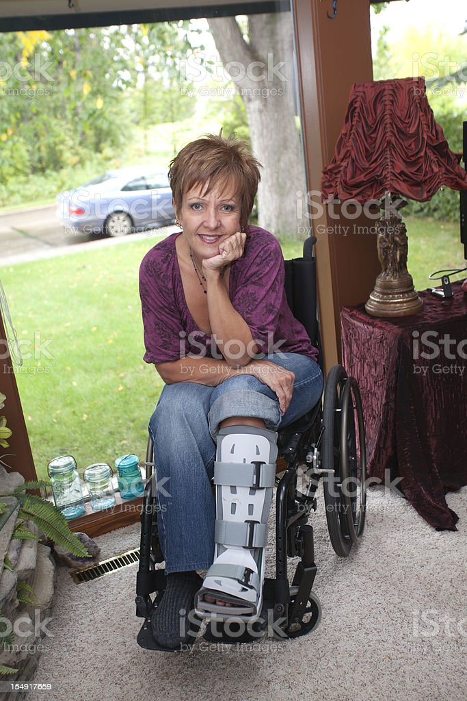 Beautiful woman in wheelchair royalty-free stock photo