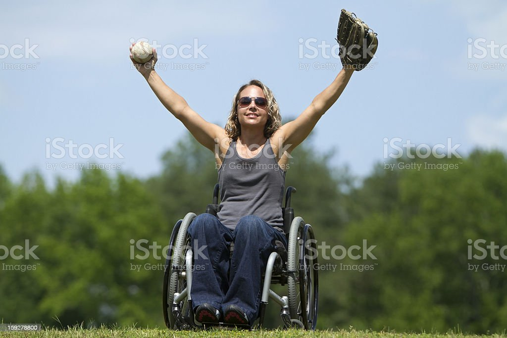 Beautiful Woman in Wheelchair Playing Catch royalty-free stock photo