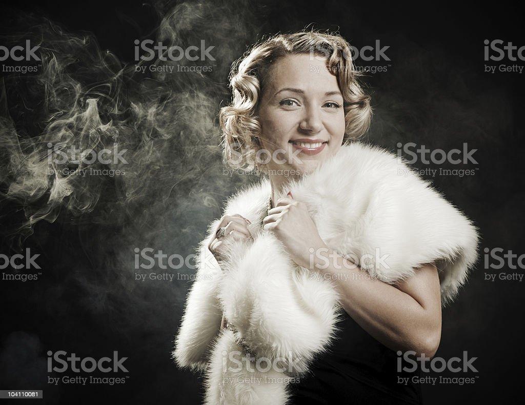 beautiful woman in white fur royalty-free stock photo