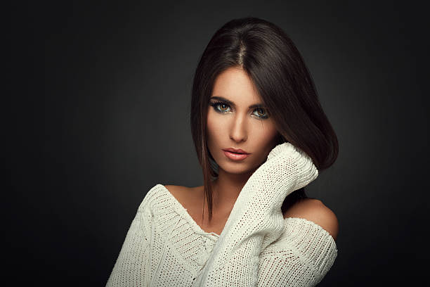 beautiful woman in white sweater - medium length hair stock photos and pictures
