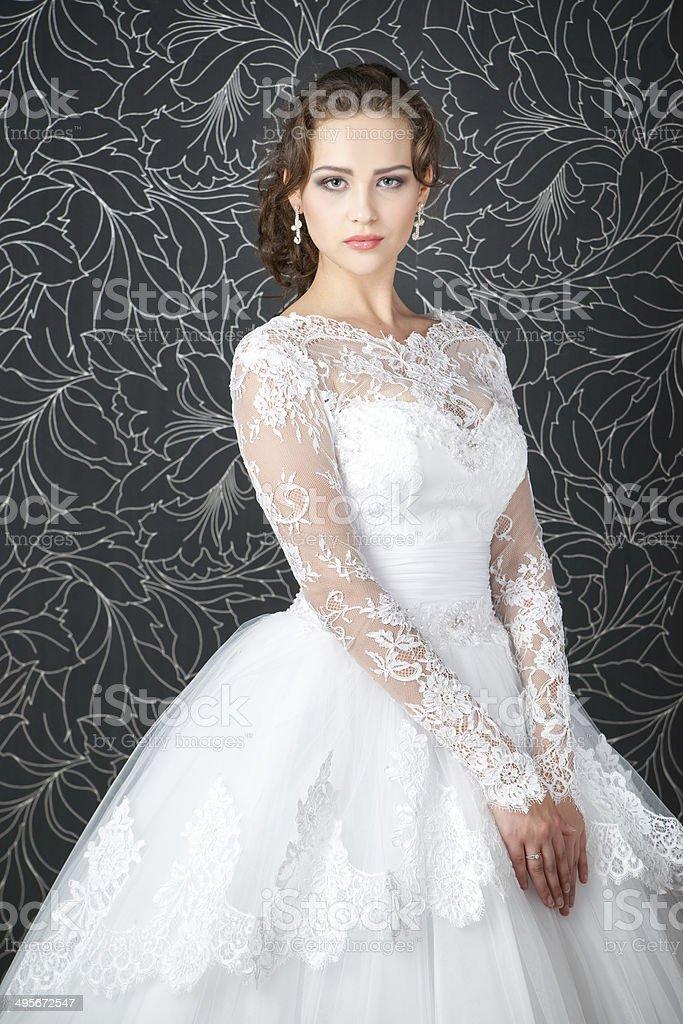 Beautiful woman in white wedding dress stock photo